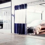 Car painter in automotive facility