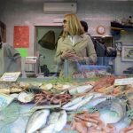Our chef-for-a-day picked one of the most famous fishmongers in town for her foodshopping. She is listening to the expertise of the shop owner to buy the best octopus, the main ingredient of the recipe
