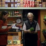 Our chef-for-a-day checks her shopping list. She has chosen to visit a famous grocery store in the South of Milan whose vegetables are all of prime quality and carefully chosen