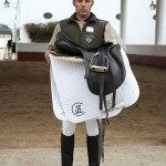 José Ramón Tirado García holding a saddle