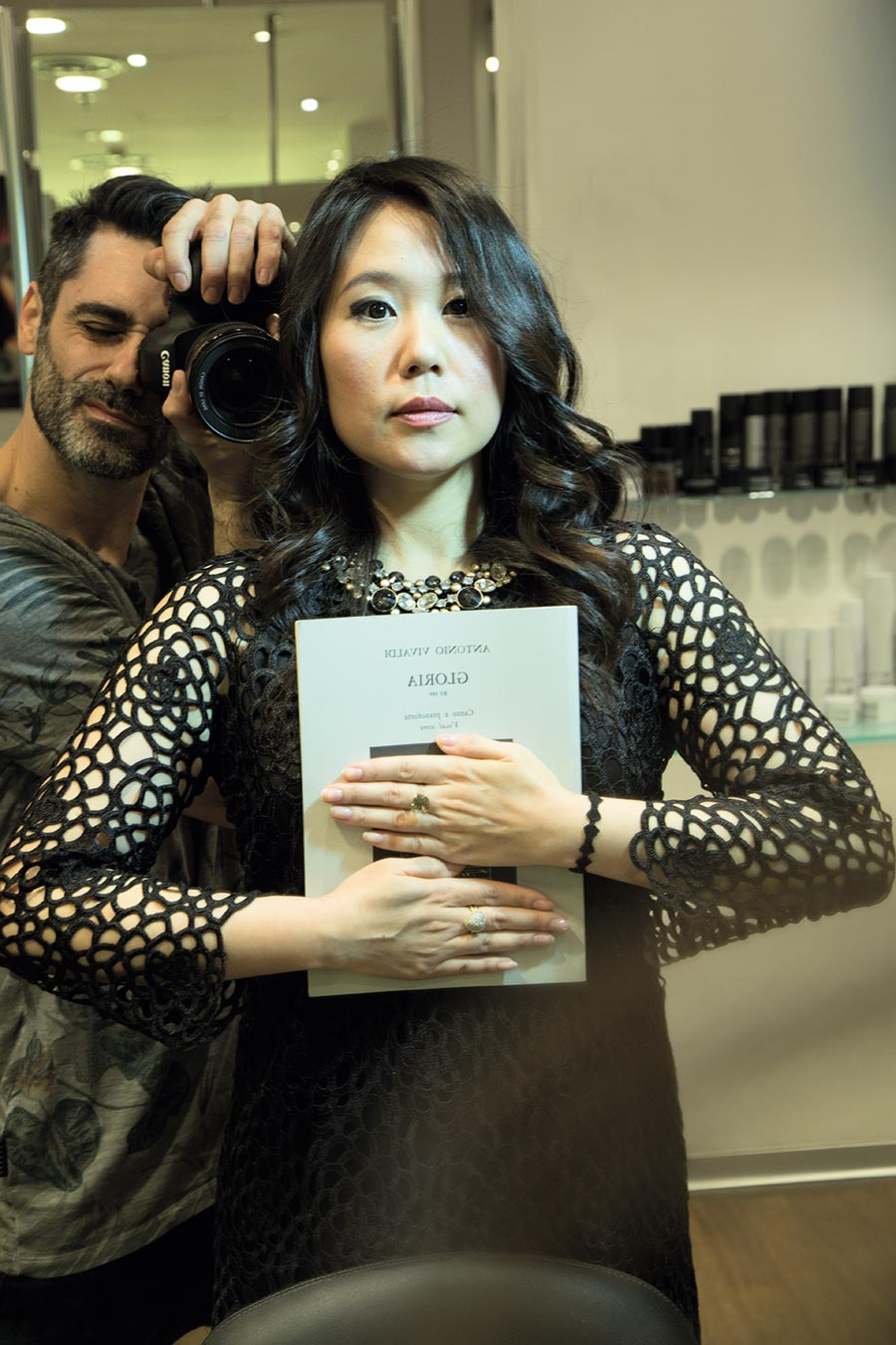 The opera singer Moon Jin Kim holds one of her scores while posing for the photographer Max Di Vincenzo. Photos by Max Di Vincenzo, Milan, Italy