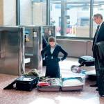 Natalie Keener tries to reduce her luggage at the airport before leaving on a business trip with Ryan Bingham.