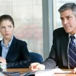 Natalie Keener (Anna Kendrick) listens as Ryan Bingham (George Clooney) prepares to fire someone.