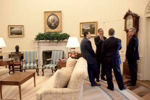 Obama and his advisors in the Oval Office