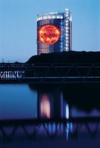 Gasometer with image of the sun. Photo by Wolfgang Volz